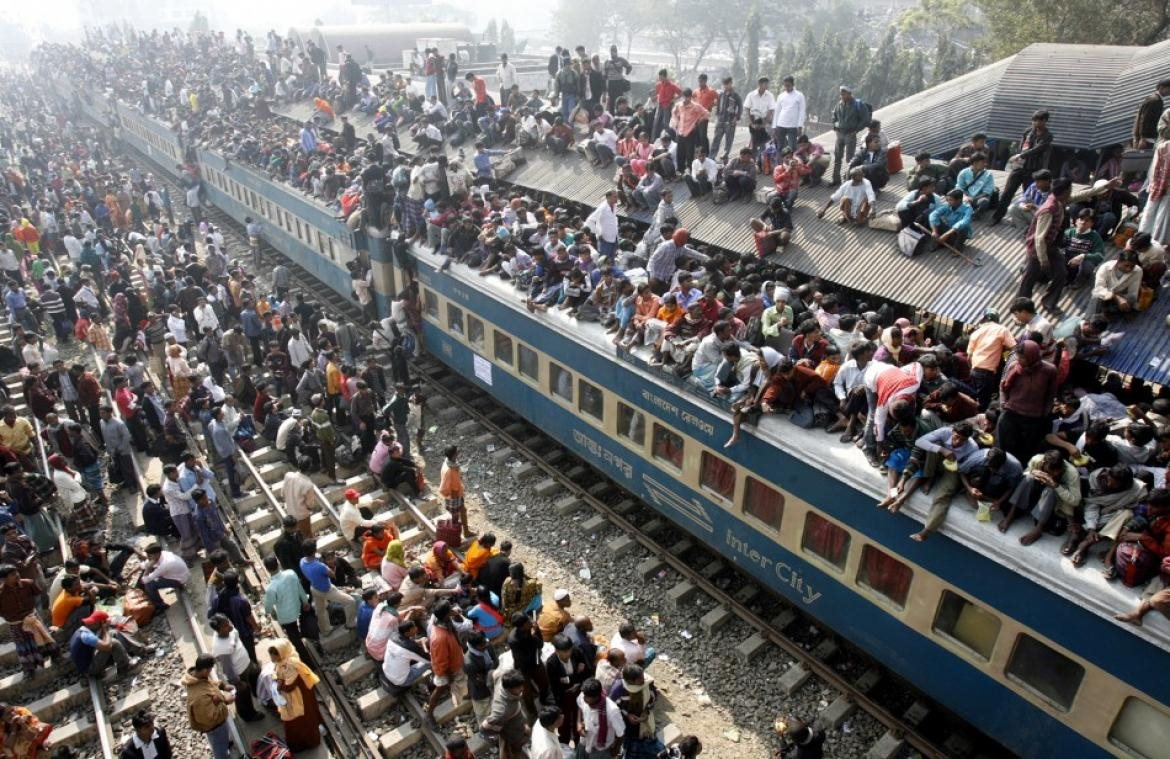 142148-people-try-to-board-a-crowded-passenger-train-to-take-part-in-the-nat-
